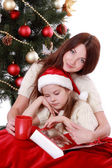 Mother and daughter over christmas tree — Stock Photo