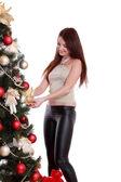 Girl decorate Christmas tree — Stock Photo