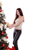 Girl decorate Christmas tree — Stockfoto