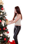 Girl decorate Christmas tree — Stock Photo