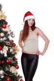 Girl in red Santa hat — Stock Photo