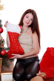 Woman holding presents on Christmas — Stockfoto