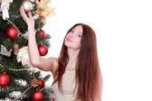 Woman over Christmas tree — Stock Photo