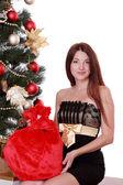 Woman sitting over Christmas tree — Stok fotoğraf