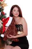 Woman and toy bear over Christmas tree — Stock Photo