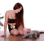 Woman playing with cat — Stock Photo