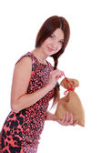 Young woman holding Santa bag — Stock Photo
