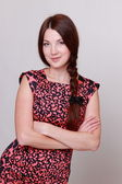Beautiful woman wearing colorful dress — Stock Photo