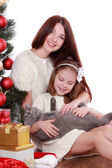 Mother and daughter cat over Christmas tree — Stock Photo