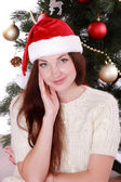 Studio portrait of attractive smiley young woman on Holiday theme — Stockfoto