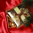 Gift box with golden christmas balls — Stock Photo
