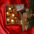 Gift box with golden christmas balls — Stock Photo #36355085