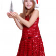 Little girl with small christmas tree — Stock Photo