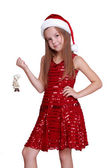 Little girl with decorative doll on Christmas — Stock Photo