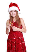 Little girl holding a Christmas toy — Stock Photo