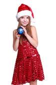 Little girl holding christmas ball — Stock Photo