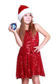 Little girl holding christmas ball — Stockfoto