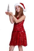 Girl with small christmas tree — Stock Photo