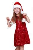 Little girl holding christmas balls — Stock Photo