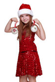 Little girl wearing a Santa Hat — Stock Photo