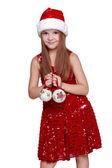 Little girl wearing a Santa Hat — Stock Photo