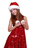 Little girl in Santa hat on Holiday theme — Stock Photo