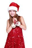 Dívka drží vánoční dekorace — Stock fotografie