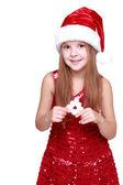 Dziewczyna ubrana w czerwoną sukienkę i czerwony kapelusz santa — Zdjęcie stockowe