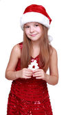 Girl dressed in a red dress and red santa hat — Stock Photo