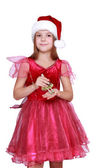 Girl wearing santa hat — Stock Photo