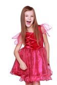 Girl showing her pink carnival costume — Stock Photo