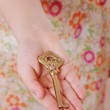 Little girl hand with an old key — Stock Photo #39207961