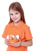 Girl holding eggs — Stock Photo