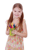 Girl with colored pencils in hands — Stock Photo