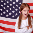 Stock Photo: Girl on background of large Americflag