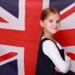 Girl against the background of the flag the UK — Stock Photo
