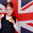 Stock Photo: Schoolgirl on background of flag UK
