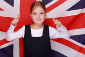 Girl on background of the flag of Great Britain — Stock Photo