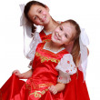 Little girls wearing traditional costume — Stock Photo #39502035