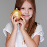 Little girl playing with Christmas ball — Stock Photo