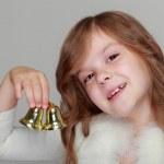 Little girl holding Christmas bells — Stock Photo #39509507