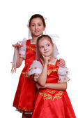 Little girls wearing traditional costume — Stockfoto