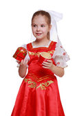 Girl holding doll in tradition style — Stockfoto