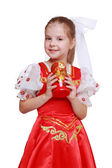 Girl holding doll in tradition style — Stock Photo
