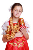 Girl wearing traditional russian costume — Stockfoto