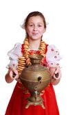 Girl holding vintage samovar — Stock Photo