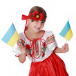 Girl holding an Ukrainian flags — Stock Photo #39518775