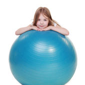 Young girl jumping on a fitball — Stock Photo