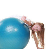 Girl on a fit ball — Stock Photo