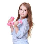 Chica haciendo ejercicios con pesas — Foto de Stock